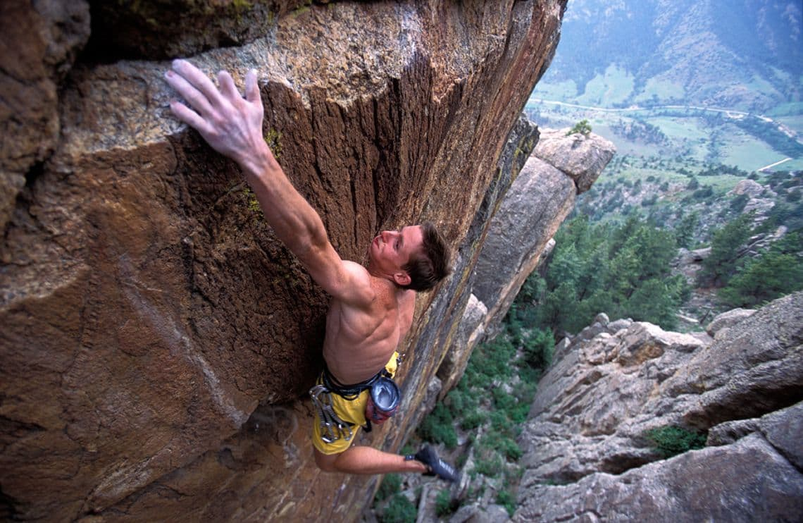 man rock climbing Grand Ol' Opry 5.14b at the Monastery near Estes Park, Colorado.