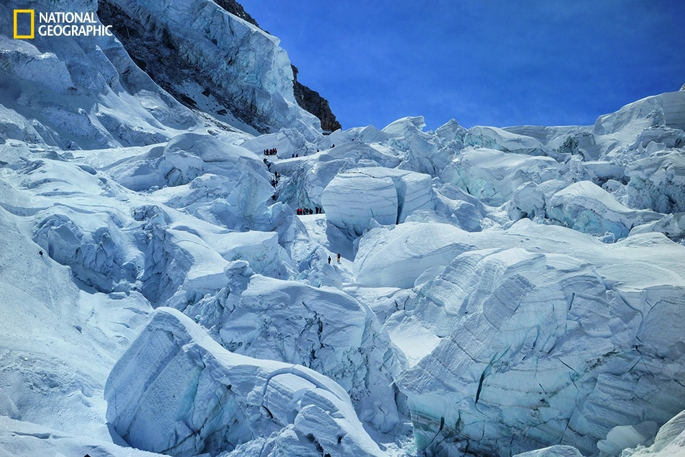 Photo by Andy Tyson/National Geographic April 18, 2014 Rescuers in the Khumbu Icefall dig for survivors and bodies among mansion-size blocks of ice about three hours after the avalanche. Eleven of the 16 victims died at a single spot at upper left, where climbers are searching.